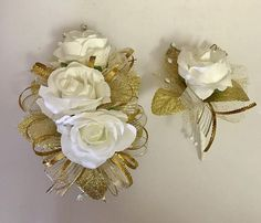 Gold ribbons, tulle and leaves. White artificial roses. Rhinestones and wristband. Corsage Set is packaged in a crystal clear corsage box for presentation. Flowers are artificial. Custom orders are welcome.