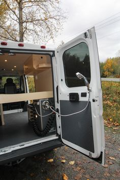 """Baja"", the 2017 Dodge Ram Promaster van built around surfboard storage. It has solar, an outdoor shower, a bed platform, and everything the coastal adventurer could need. Van Conversion Paneling, Van Conversion Project, Ford Transit Conversion, Sprinter Van Conversion, Brick Oven Outdoor, Outdoor Bars, Surfboard Storage, Camper Bathroom, Camper Van Life"