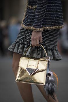 Chic gold handbag and a sharp skirt