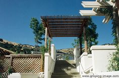 Arbor above exposed aggregate concrete stairs — Lucas Valley, San Rafael