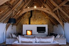 Medieval Tithe Grade II* Listed Barn Conversion by The Bazeley Partnership Architects in Cornwall Barn Conversion Interiors, Granite Hearth, Stove Installation, Agricultural Buildings, Interior Architecture, Interior Design, Living Room Decor, Living Rooms, Home And Family