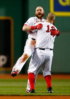 Jonny Gomes #5 and Mike Napoli #12 of the Boston Red Sox celebrate after defeating the Detroit Tigers 6-5 in Game Two of the ALCS .