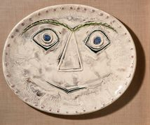A surprised face. A ceramic plate by Picasso.