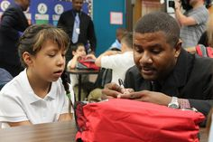"""""""Back to School, Back to Health"""" -- 10,000 backpacks are filled by volunteers with school supplies and a Heart to Heart Care Kit and distributed on the first day of school."""