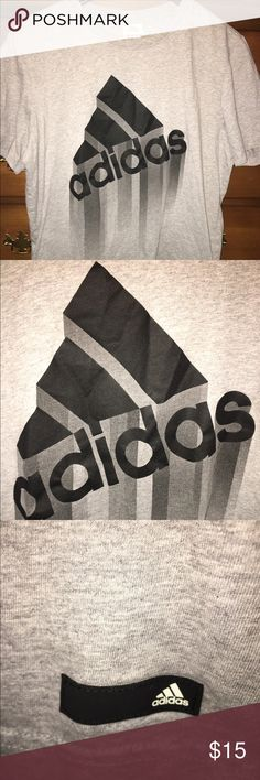 Gray oversized adidas shirt grey athletic t shirt Men's size large. This adidas graphic t shirt is in good condition! This shirt features a black and dark grey adidas logo on the front. The true color of the shirt is light grey. Don't miss out on this great deal!   Adidas, athletic, work out, running, shirt, t shirt, top, gray, grey, black, logo, Adidas Shirts Tees - Short Sleeve