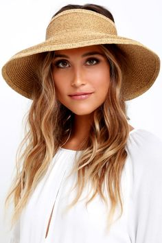 Protect yourself from sun rays all while looking fab in the San Diego Hat  Co. This woven travel-friendly visor unrolls from its handy elastic closer  to a ... 40bcfa5d56f1
