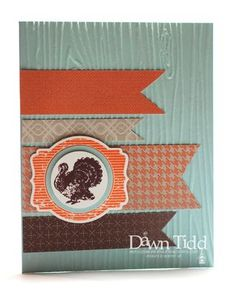 "Outside of Card Stamps: Harvest of Thanks Paper: Soft Sky & Whisper White Card Stock; Sweather Weather Designer Series Paper Ink: Chocolate Chip & Tangerine Tango Tools: Big Shot, Woodgrain Embossing Folder, Deco Label Framelits, 1 1/4"" & 1 3/8"" Circle Punches, Modern Label Punch"