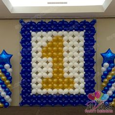 1st Birthday Balloon Wall and stage decor. Great way to celebrate a first birthday for your little star. #partywithballoons