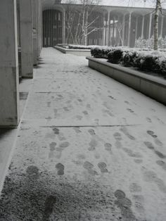 Footprints in the snow on #UAlbany's Academic Podium.