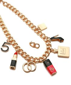 What's not to love? Ladies Night Out Fashion Charm frontal necklace, crafted from gold-tone mixed metal, features acrylic charms shaped like lipstick, heels, perfume, all the things needed to turn fashion into style.