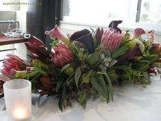 flower arrangements for weddings long | Natives and callas Head table arrangement