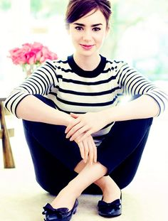 Lily Collins for Elle Russia black and white striped top, black trousers, black flats