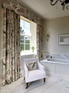 This elegant bathroom in an Oxfordshire stately home has the most beautiful outlook. Windows are framed with a gorgeous set of curtains in a Christopher Farr 'Carnival' fabric and pelmet to match. Small Cushions, Royal College Of Art, Printed Linen, Beautiful Bathrooms, Clawfoot Bathtub, Master Suite, Color Patterns, Carnival, Upholstery