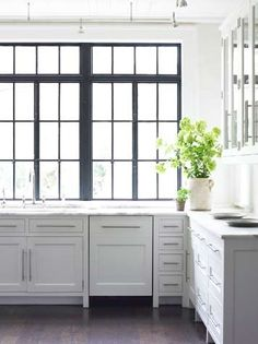 Black painted mullions in a white kitchen  Carter Kay via Marcus Design Inc.