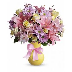 Pretty pastels and delicate flowers make this a feminine classic for your sister, friend or mother. Tied with a bow, the pale yellow vase is filled with soft pinks, purples and yellows - sure to delight her on her special day! Mothers day #Flowers Delivery
