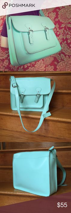 """Joe Fresh Mint Green genuine leather messenger bag This is such a fun bag! Mint green (like the ice cream) genuine leather cross body messenger bag with magnetic snap (buckle) closures. Adjustable cross body strap. Used a few times, so there's normal but minor dirt marks inside the bag, which is unlined(it's a raw leather). No inside pockets but there is one outside front pocket underneath the flap. 13.25"""" Length, 11.25"""" Height, 4"""" depth. Strap thickness is 1.25"""" , strap drop is 19.5"""" up to…"""