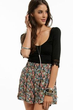 crochet sleeve black top - could easily DIY this by sewing on a strip of lace or crochet trim onto a black scoop neck shirt