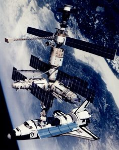 This technical rendition of Atlantis docked to the Kristall module of the Russian Mir Space Station shows the largest space platform ever assembled, which was completed June of 1995.