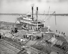 Angola Landing 1910,  Angola Prison Farm, Mississippi River.  The Sternwheeler America owned by Captain LeVerrier Cooley.  The bell at the front of the boat can be seen at his grave at Metarie Cemetery, New Orleans.