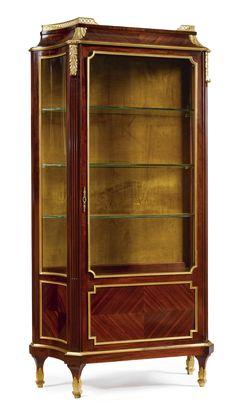 c1900 Victor Raulin  FL. 1867-1925  A LOUIS XVI STYLE GILT BRONZE MOUNTED MAHOGANY AND QUARTER VENEER SATINÉ VITRINE  Paris, circa 1900    Estimate  7,000 — 10,000  USD. unsold