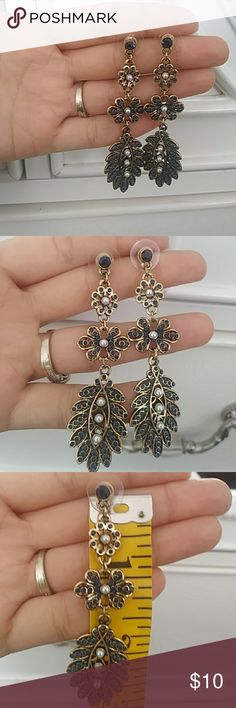 Long dangly earrings Gorgeous long dangly earrings with dark blue rhinestone details and Tiny pearls. All of the rhinestones are intact including the pearls beautiful statement piece earrings from the brand ModCloth. Modcloth Jewelry Earrings