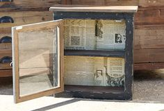 This version is from Antique Farm House - but the look (old wood, window as door, book pages) says salvage!