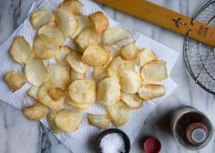Baked Chips (Salt & Vinegar) 2 russet potatoes 1 1/2 cups vinegar Pam Salt Instructions 1. Peel the potatoes. Slice thin. 2. Place the potato slices in a mixing bowl and pour the vinegar in. Let sit for 2 hours. 3. Heat oven to 350 degrees 4. Dry slices, spray cookie sheet & slices with cooking spray sprinkle with salt, Bake 8 minutes turn chips & bake for an additional 8-10 minutes