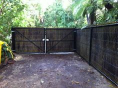 "The reverse view from my previous pin showing the behind the scenes view of this particular fence job  Previous pin:  ""Western Australian brushwood panels installed!  Attached to ""top rail"" chain link fencing, the brushwood (50mm) screening has that unique and natural look and also has the added strength and durability of top and bottom rail, black plastic coated, chain link fencing supporting it."""