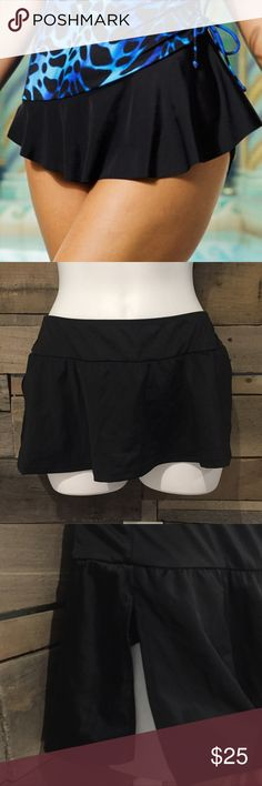 "🆕 Longitude black swim skirt. Size medium NWT Longitude black swim skirt. Size medium. 9"" long Longitude Swim Bikinis"