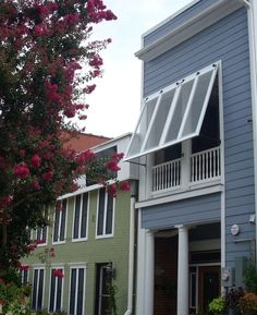 Take a look at this splendid gray shutters - what an imaginative version Bermuda Shutters, Bahama Shutters, Valances & Cornices, House Shutters, Exterior Shutters, Outdoor Shutters, Shutter Colors, Window Styles, Decks And Porches