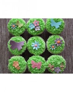 Grass Cupcakes - These grassy cupcakes from cupcakekeira look like a spring meadow in bloom. Vanilla cupcakes are frosted with tinted vanilla buttercream and decorated with flowers and butterflies molded from flower paste.