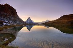 sunset behind the Matterhorn with reflections in Riffelsee Lake, Swizerland