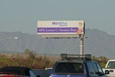 Billboard for MomDoc Midwives on the Santan Freeway Loop 202.  40% Lower C-Section Rate  MomDoc Midwives www.MomDocMidwives.com Drs. Goodman & Partridge, OB/GYN Beautiful Beginnings Partnering with you for a healthy pregnancy and a healthy baby. To s (Learn a Little-Known, But 100% Scientifically-Proven Way To ERASE Your Diabetes in 3 SHORT weeks)