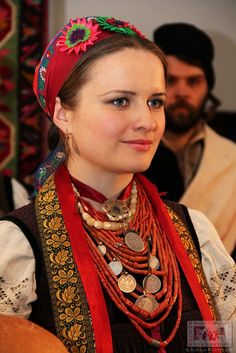 A girl in a Ukrainian outfit and traditional jewelry