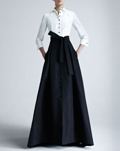 """Carolina Herrera evening gown in two-tone silk taffeta. Approx. length: 61""""L from shoulder to hem, 68""""L down center back. Convertible spread collar with contrasting buttons. Three-quarter sleeves with"""