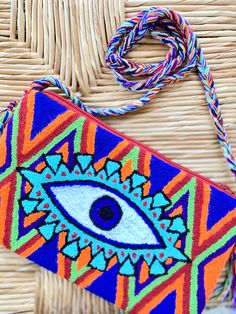 Handmade item by our Wayuu Tribe in La Guajira, Colombia. To make a single piece can take 3 to 4 weeks. Three different ways to rock your clutch bag, crossbody it, also carry it as a shoulder bag, or just as a fanny pack! Line Patterns, Single Piece, Clutch Bag, Purple, Pink, Handmade Items, Turquoise, Shoulder Bag, How To Make