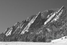 Boulder Colorado flatirons with a fresh snow powder dusting. February Winter landscape View.  Fine art photography prints, decorative canvas prints, acrylic prints, metal print wall art for sale on FineArtAmerica.com. Prints starting at $25. Copyright: James Bo Insogna