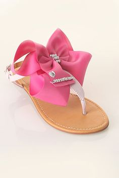These are super cute-cute, but they are for adults and cost over one hundred dollars! They would be super easy to make for a little girl-just get a pair of Pay-less sandals, Scotch-proof some ribbon, make a bow-bling it out-hot glue or sew on. Not the sturdiest shoes-but adorable for a special outfit!