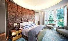 'There is a feeling about those curves - a mystery to them - that relaxes me,' says Pushelberg of the master bedroom. The curved-metal geometric-patterned headboard is a Yabu Pushelberg design.