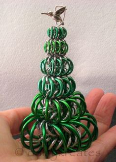 chainmaille christmas tree  uses the whirlybird pattern, two pins about that.....
