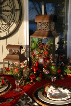 Lanterns with Christmas ornaments, pine cones and greenery,  Home is Where the Boat Is