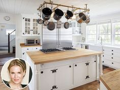 Look Inside These Gorgeous Celebrity Kitchens | RENÉE ZELLWEGER | The actress's 38-acre Connecticut farmhouse property might have been built in 1770, but the kitchen has high-tech stylings like a six-burner stove and massive stainless-steel refrigerator that would please any aspiring chef today.