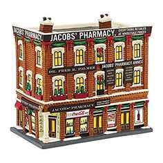"Department 56 Christmas in the City Village Jacobs' Pharmacy Light House, 8.07"" - Department 56 has been creating seasonal memories for families since 1976 - Artist designed; globally recognized for q"