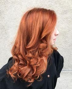 Bright copper red hair color by Aveda artist Stephanie Diaz.