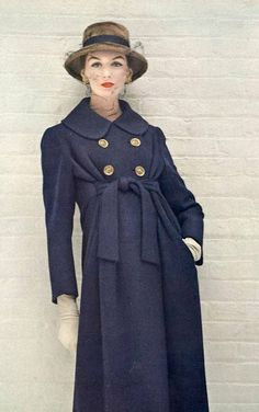1956 Lucinda Holligsworth in blue tweed coat that is belted just around the ribs by ben gershel
