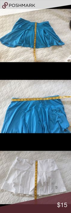 Tennis Skirt bundle, Adidas and K-Swiss bundle One blue Adidas with built in shorts (no rubber grippers)  and one white tennis K-Swiss skirt, (no rubber grippers). Size is large or regular 8, I'm 5'11 and wear 8 in lulu and these fit me fine. Adidas Skirts Mini