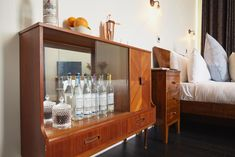 Opened in 2017, this is a working gin distillery in what was once a notorious Notting Hill boozer. There are three mid-century rooms, a bar and restaurant, and the hotel produces its own Portobello Gin from a copper still on site – ingredients include citrus, juniper, Indonesian-sourced nutmeg and orris from Italy. Think you can do better? There's a Ginstitute on site, where guests can create their own gin using a blend of botanicals. Copper Still, Gin Distillery, Notting Hill, Portobello, Liquor Cabinet, Mid Century, England, Rooms, Restaurant