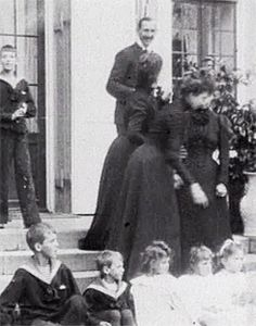 Dowager Empress Marie and her sister, future Queen Alexandra of England, at a family gathering in Denmark, 1899. Visit site for .gif