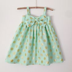 "PLEASE REFER TO SIZING CHART AND RETURN POLICIES AT BOTTOM OF PAGE! Mint and Gold Polka Dot dress named after my sweet friend's little lady Anabell. www.mintarrow.comThe ""Original"" Big Bow Dress is 100% handmade using the finest designer fabrics. Each dress is beautifully handcrafted with the best quality and attention to every detail.Wear it year round: Spring: add a light knit cardigan and Mary Jane's. Summer: by itself with cute sandals Fall: with a de..."