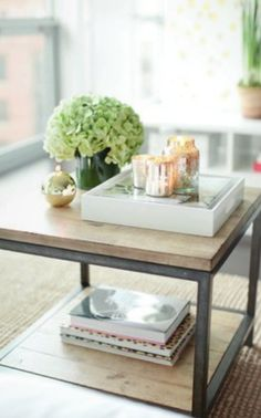 coffee table decor - could add a plank of wood to black coffee table to duplicate